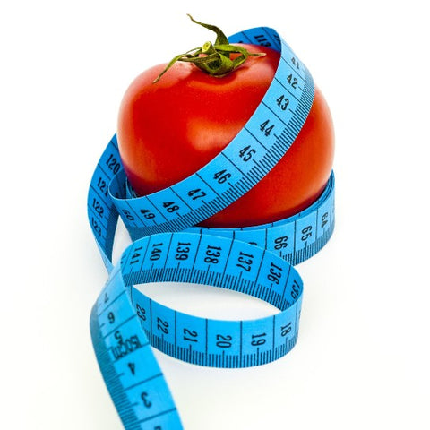 red tomato and blue tape measure