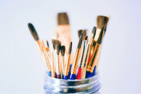 Paintbrushes in a jar