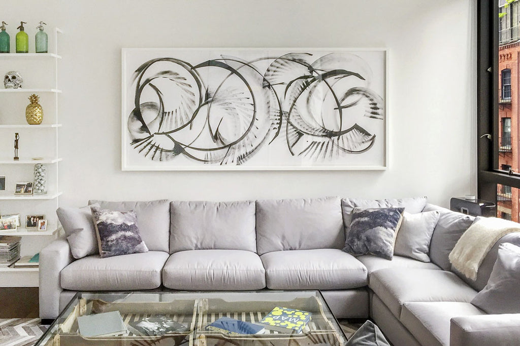How to hang art above your sofa