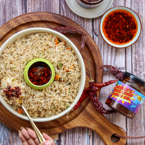 fried rice with a bowl of chilli oil to explain what chilli oil is