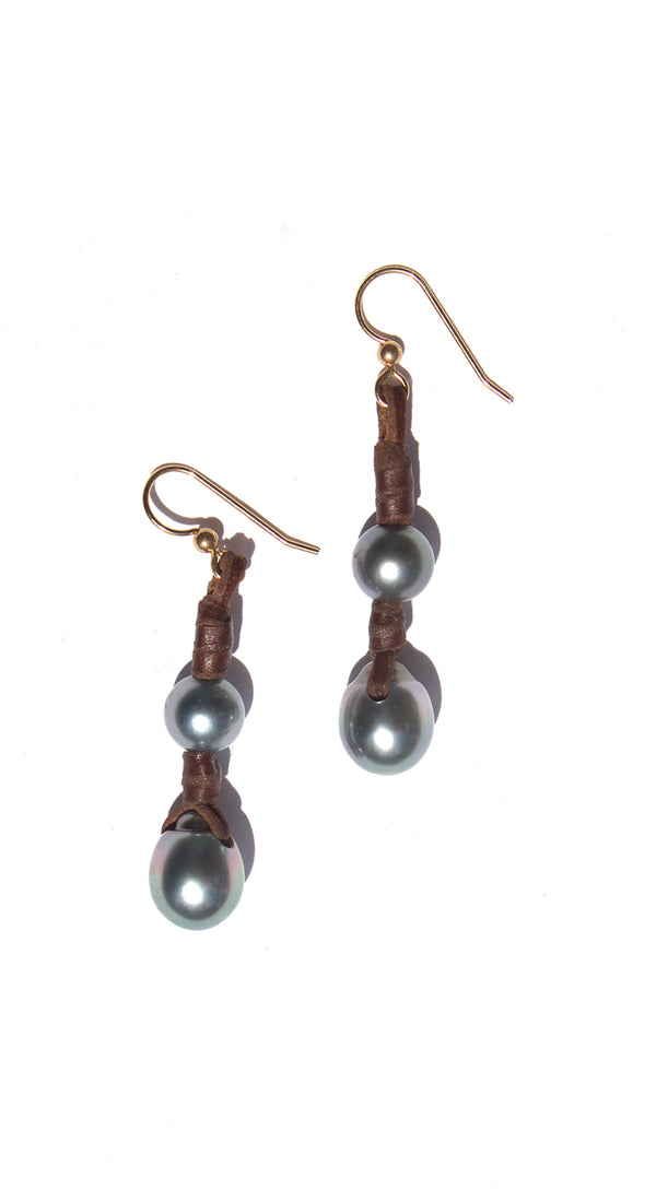 Single Pearl Earring on Knotted Leather