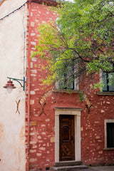 red painted house in roussillon, provence, france