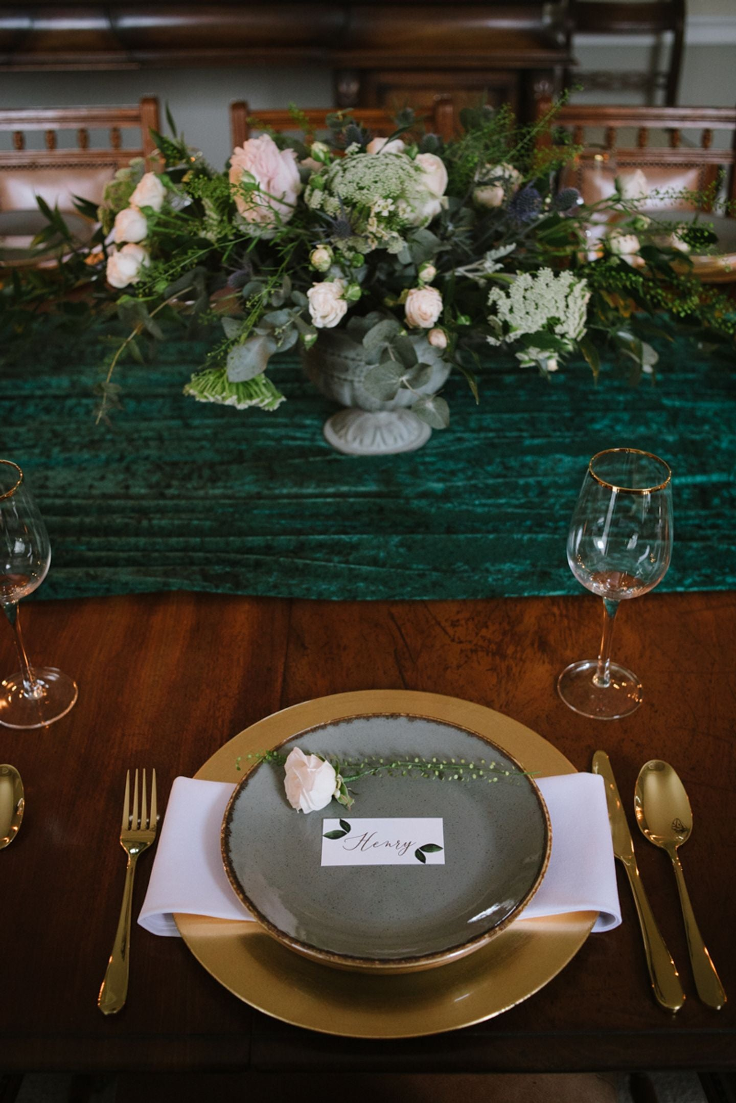 Country house table setting, rich forest green table dressing, wild flowers and hand written place cards