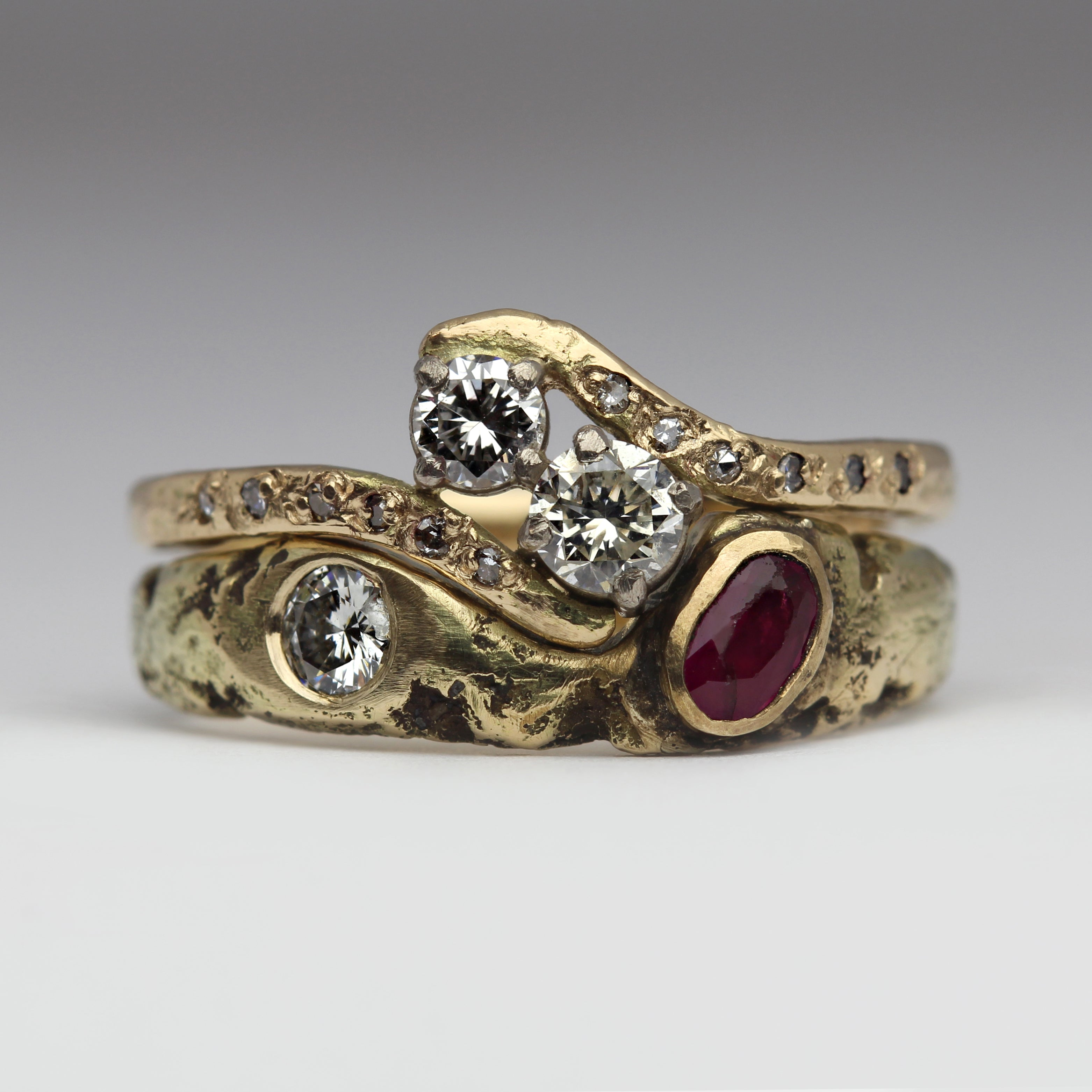 Asymmetrical contemporary wedding and engagement ring set