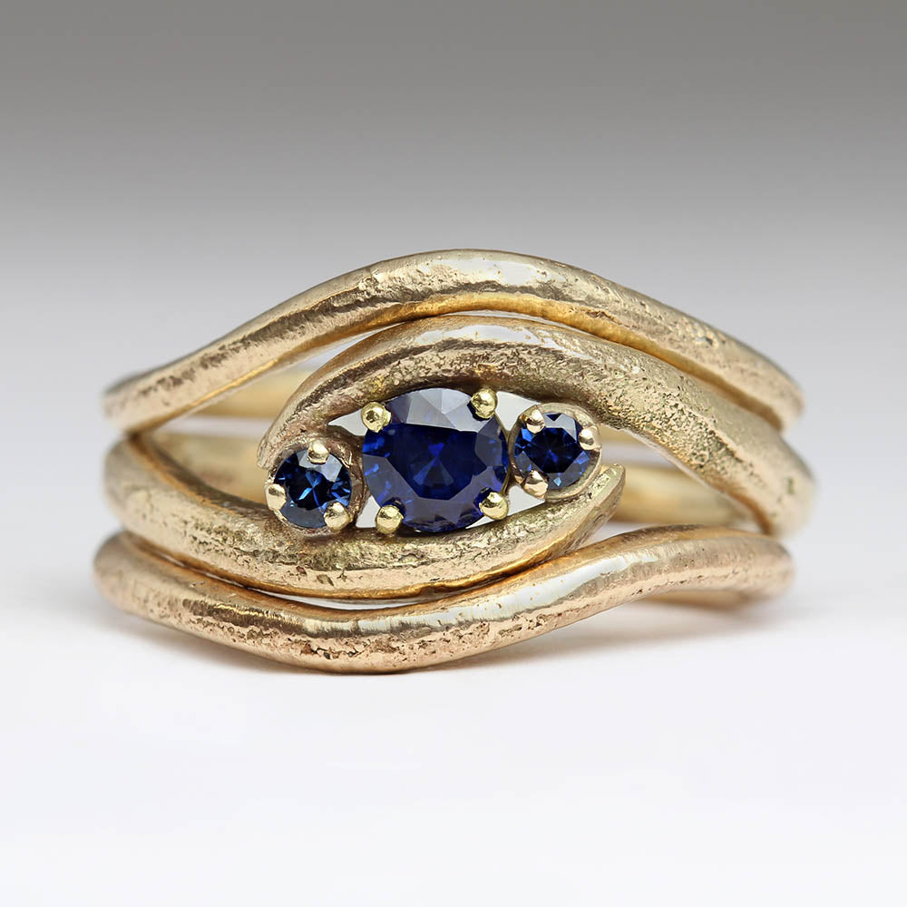 Sapphire wave engagement ring with two shaped wedding bands