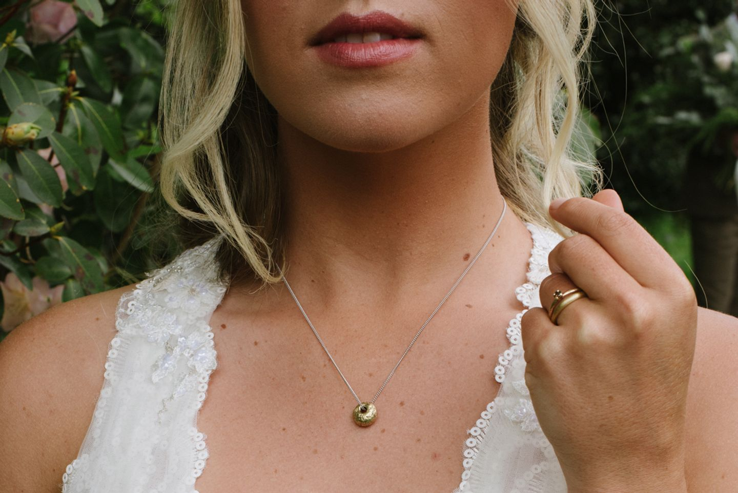 Personalised bridal pendant, gold bead cast in beach sand hangs on a contrasting chain. Sandcast wedding and engagement ring