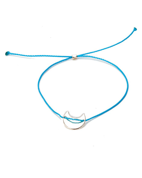 teal string bracelet with charm