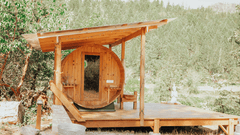 Outdoor barrel sauna with physical wooden cover.