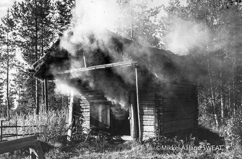 Image from Mikkel Aaland book of a burning cabin