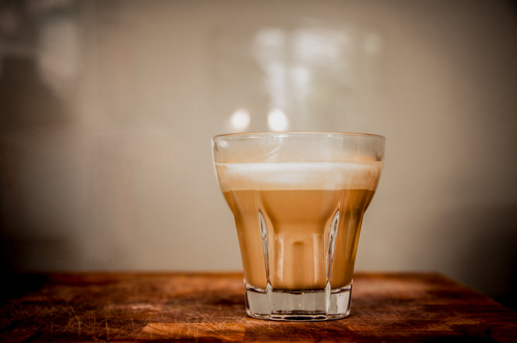 Punet coffee in glass with less milk than regular latte