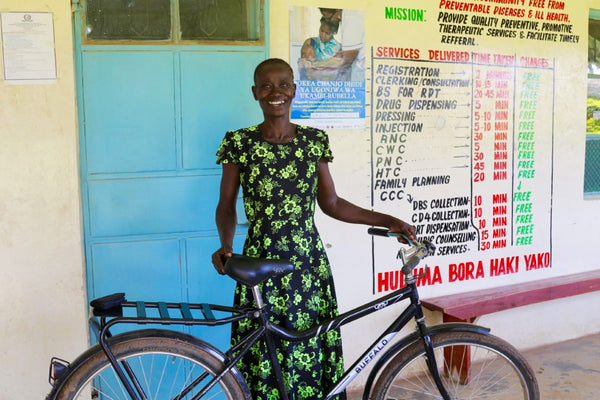 a woman with her buffalo bike from world bicycle relief