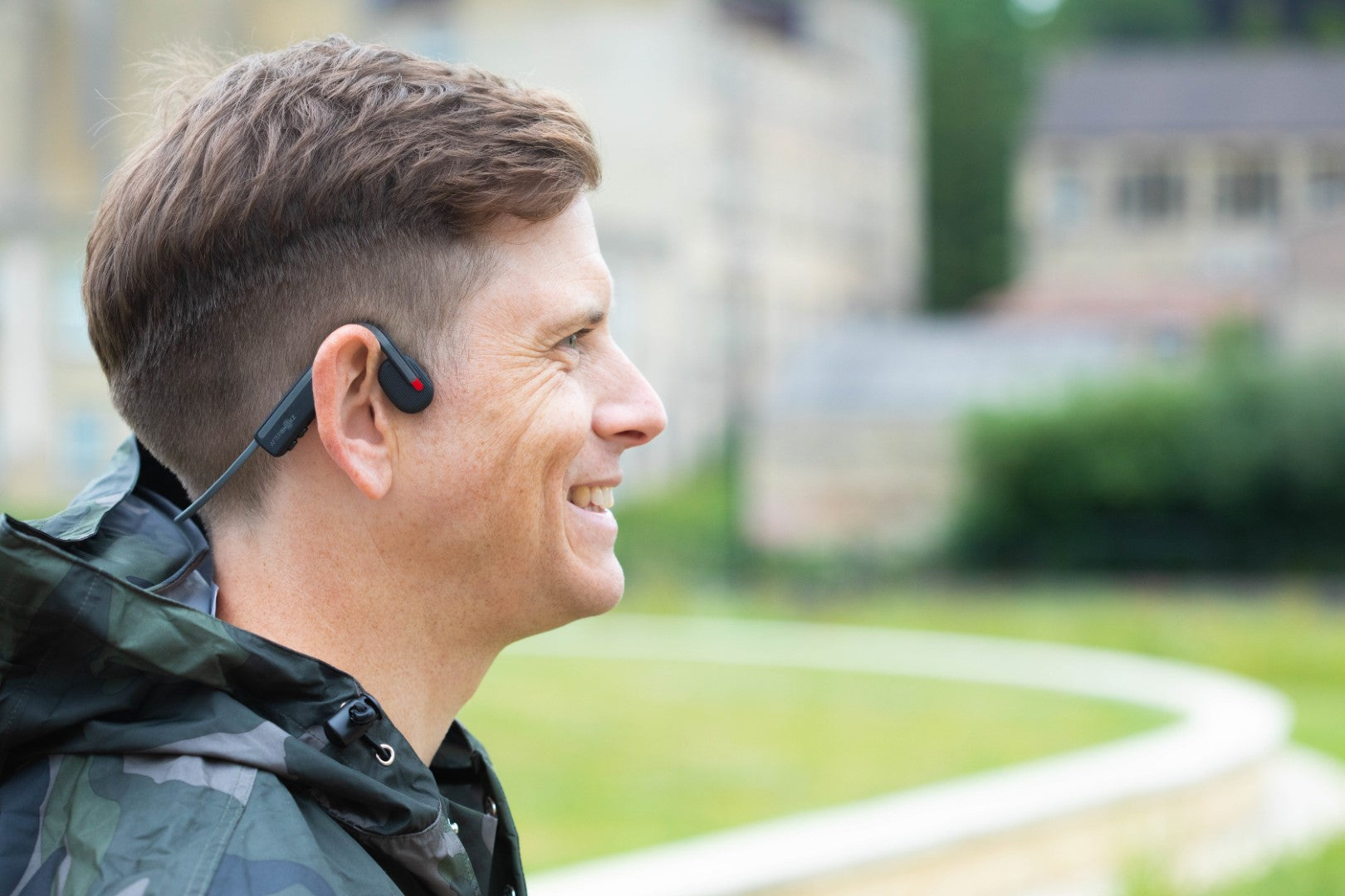 man wearing OPENMOVE bone conduction headphones by Aeropex a great way to listen to music on your bike