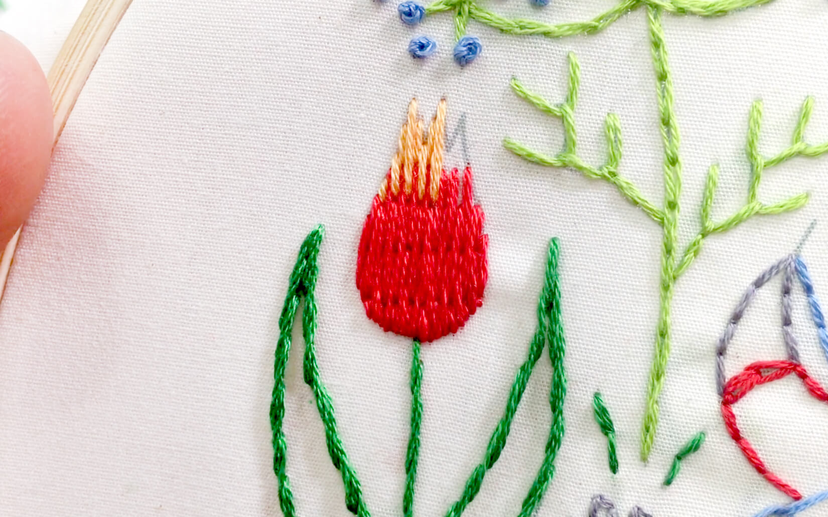 Image of long and short stitch used in the Stitching Raccoon Sampler as the tulip