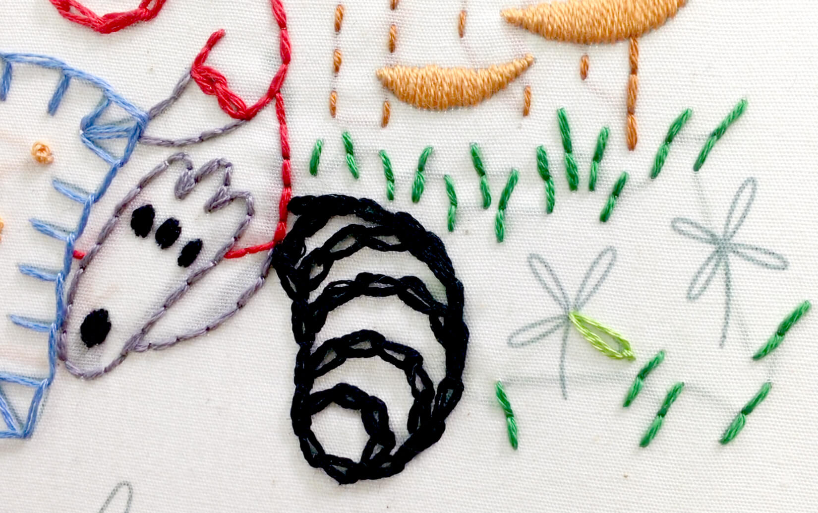 Single/detached chain stitch in the Stitching Raccoon Sampler