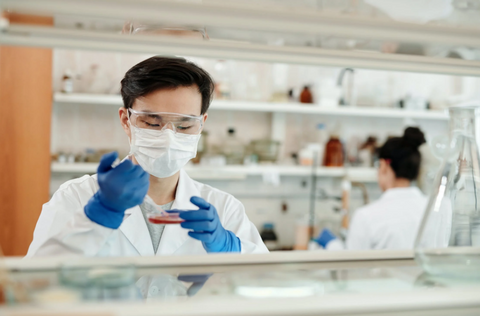 man in a laboratory researching male infertility
