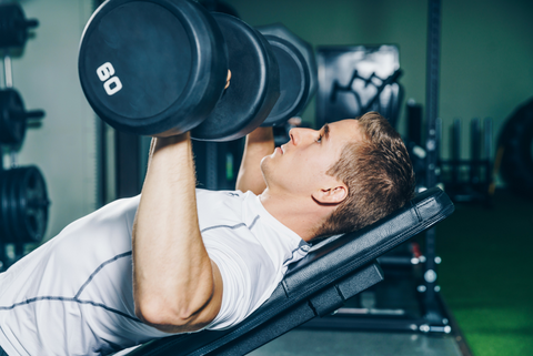 man incline dumbbell bench press