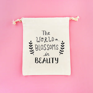 The World Blossoms in Beauty Drawstring Pouch