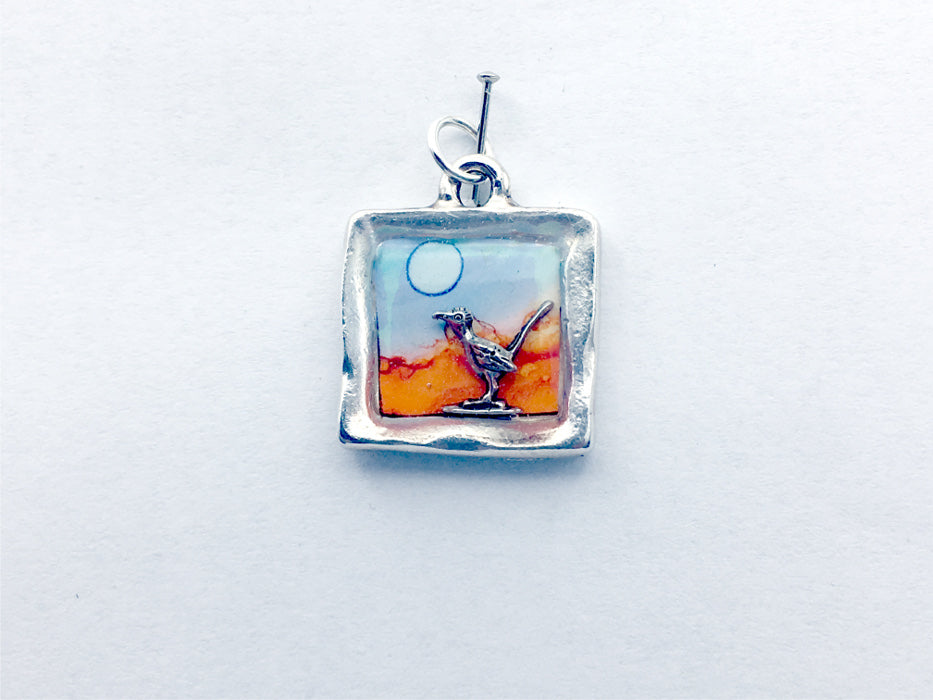 Pewter frame w/ desert scene & sterling silver road runner pendant, alcohol ink