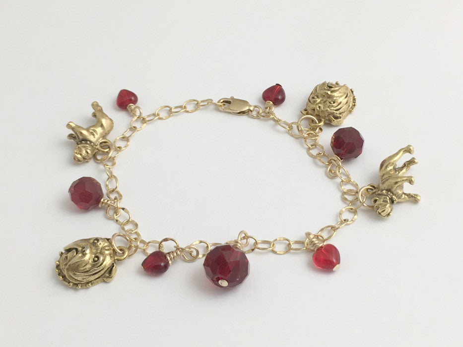 14k gold filled bracelet with goldtone pewter charms and red accent beads