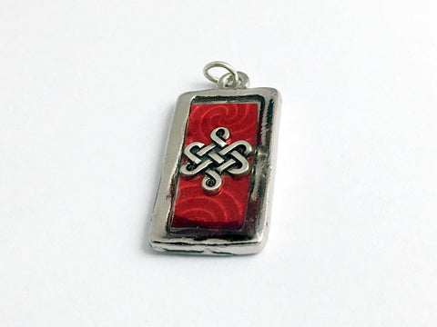 Pewter frame, red spiral holographic paper, pewter Celtic knot pendant-resin