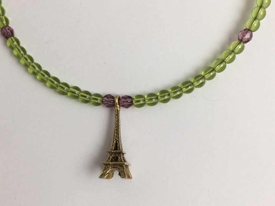 Peridot green and purple glass with Gold tone Pewter Eiffel Tower Centerpiece Memory Wire Choker