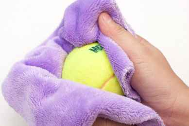 Wipe you tennis ball with a clean cloth