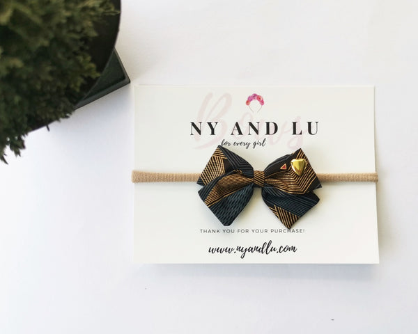 Crossover Navy and Gold abstract bow