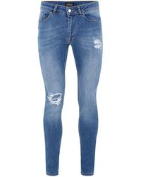ANTIOCH INDIGO RIPPED SPRAY ON SKINNY JEANS