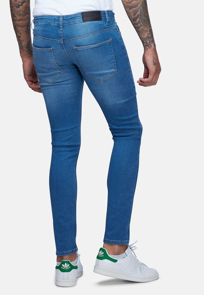 DENIM SPRAY ON SKINNY RIPPED JEANS