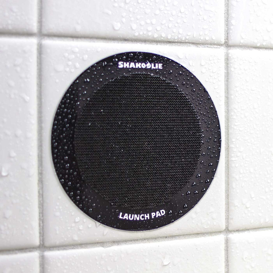 "Photo of ""The Launch Pad"" which is a thick vinyl sticker with industrial velcro that holds the foam can beverage holder on your shower wall."