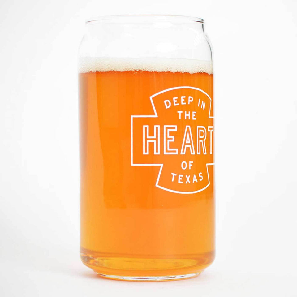 Beer can shaped glass with Deep in the Heart of Texas design in white ink - comes in four pack.