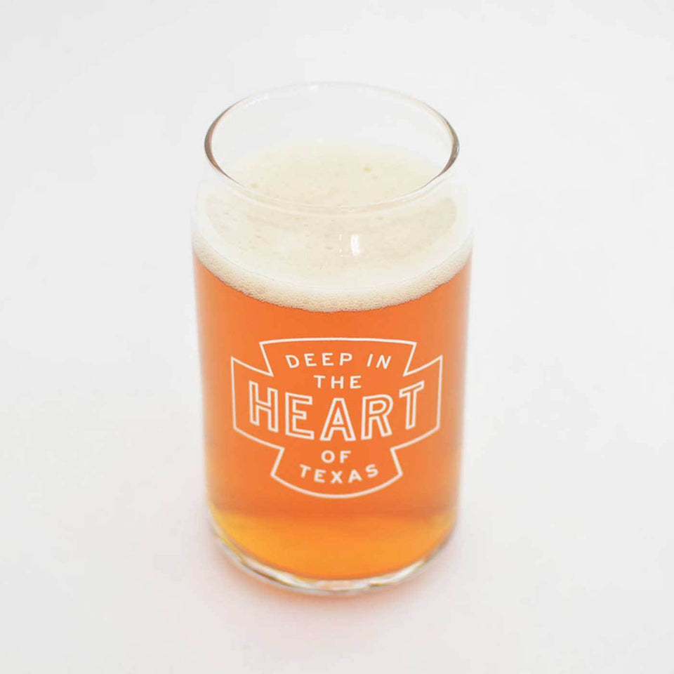 Beer can shaped glass with Deep in the Heart of Texas design in white ink- comes in four pack.