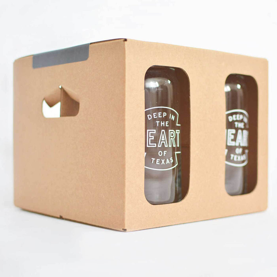 Beer can shaped glass with Deep in the Heart of Texas design with white ink packaged in a four pack box.