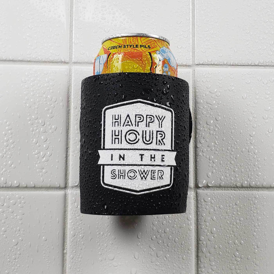 Happy Hour in the Shower design black foam can beverage holder with white ink sticking to a shower wall.