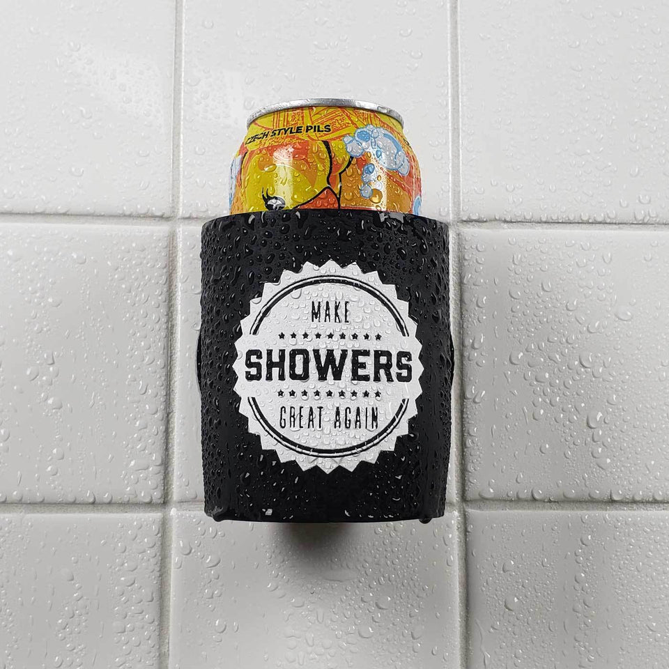 Make Showers Great Again design black foam can beverage holder with white ink sticking to a shower wall.