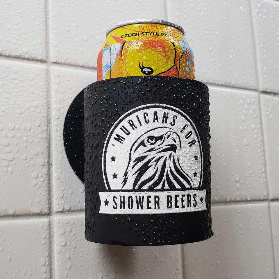 "Foam can beverage holder that sticks to shower wall via industrial velcro. This design is white ink printed on a black can holder with the words ""Muricans For Shower Beers"" written with artwork depicting a beautiful bald eagle.. This is an action shot of the product in a shower."