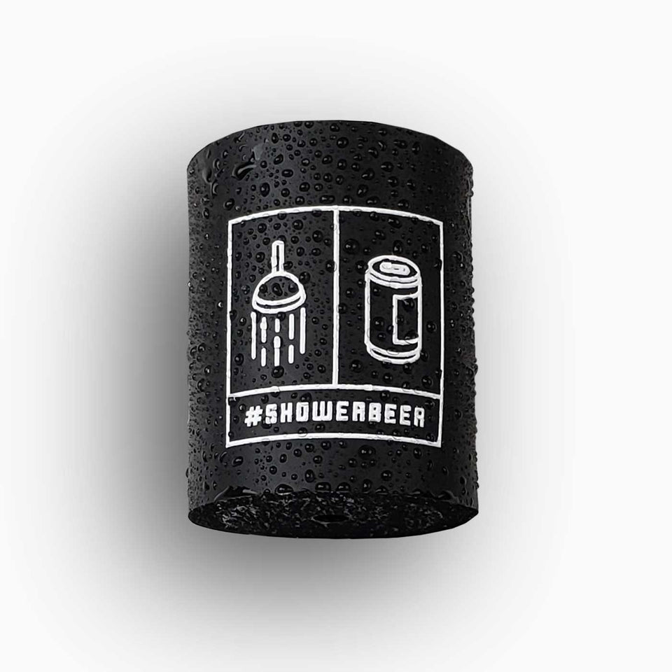 "Foam can beverage holder that sticks to shower wall via industrial velcro. This design is white ink printed on a black can holder with the words ""#SHOWERBEER"" written across the bottom and the artwork depicting a shower head and a canned beer beverage."