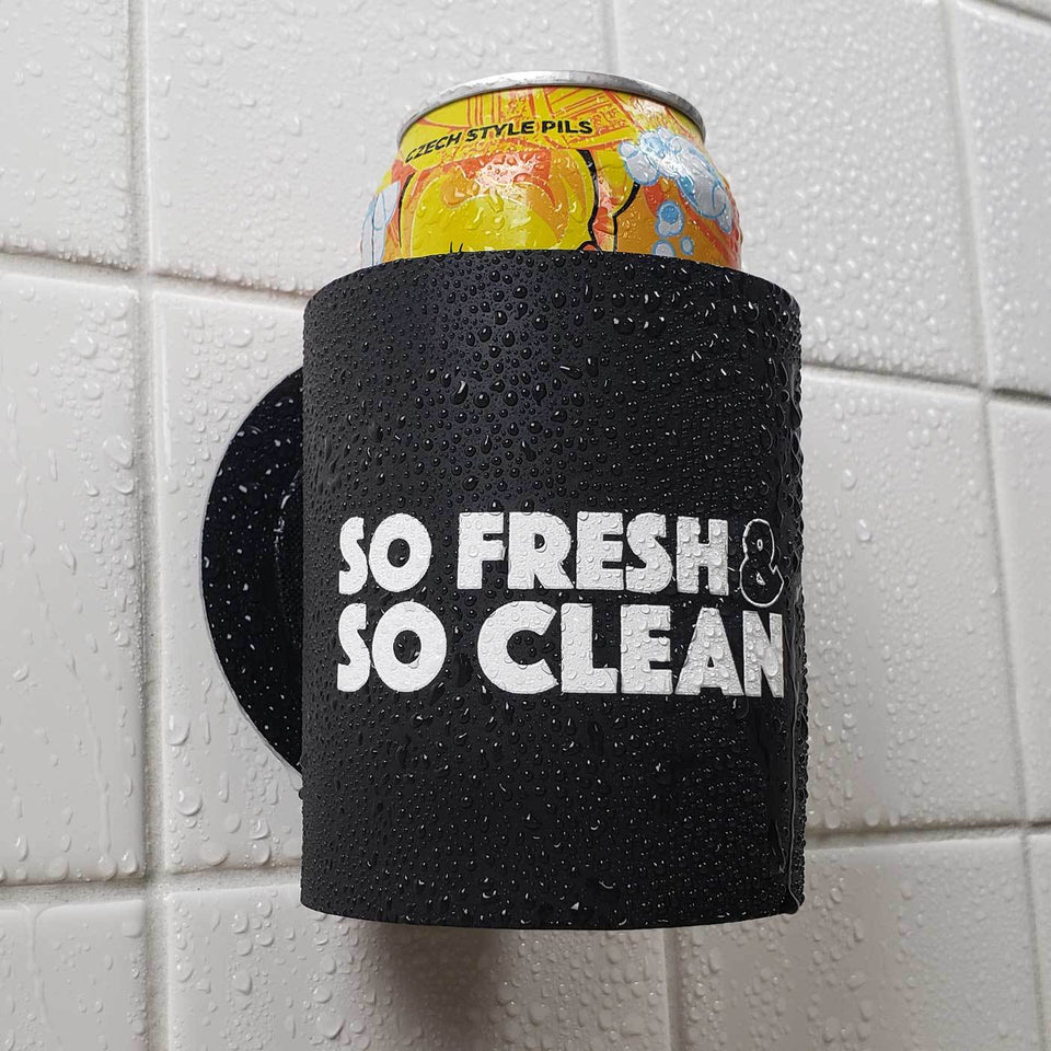 So Fresh and So Clean design black foam can beverage holder with white ink sticking to a shower wall.