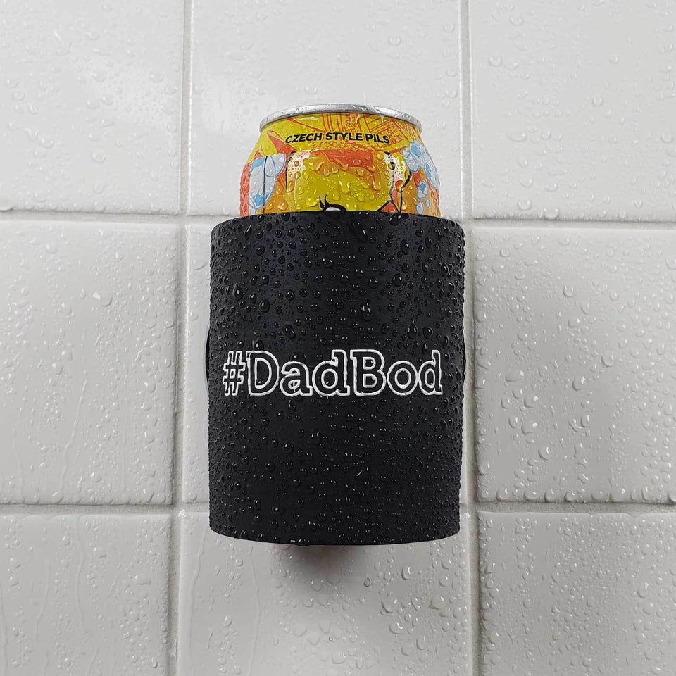 #DADBOD design black foam can beverage holder with white ink sticking to a shower wall.