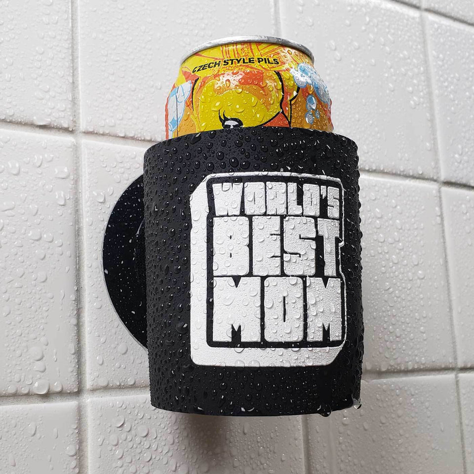 Worlds Best Mom design black foam can beverage holder with white ink sticking to a shower wall.