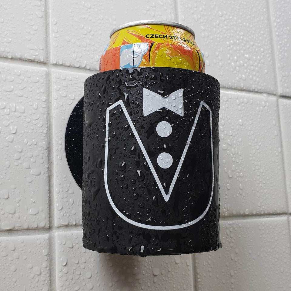 Tuxedo suit design black foam can beverage holder with white ink sticking to a shower wall.