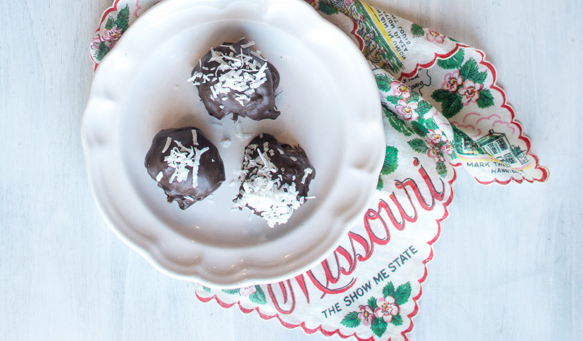 Cannabis infused peppermint coconut date balls on vintage white plate with Missouri handkerchief