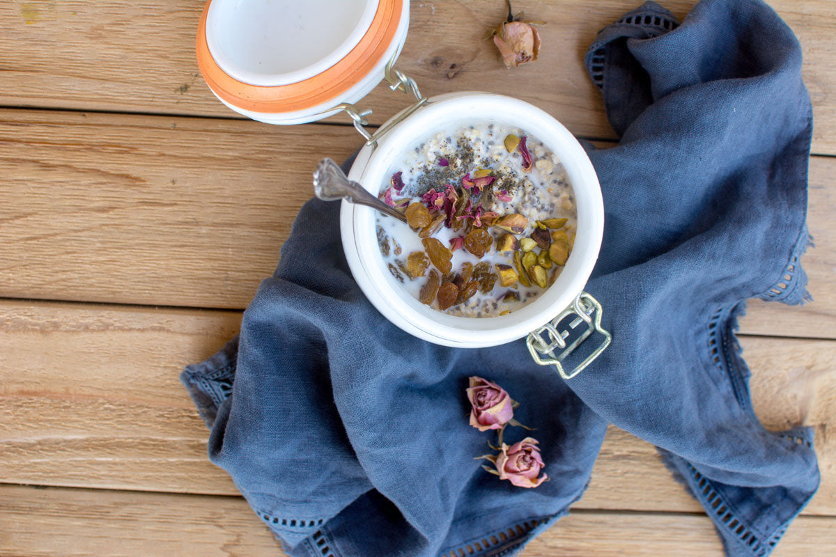 Cannabis infused overnight oats recipe styled in midwest jar and cloth on wood