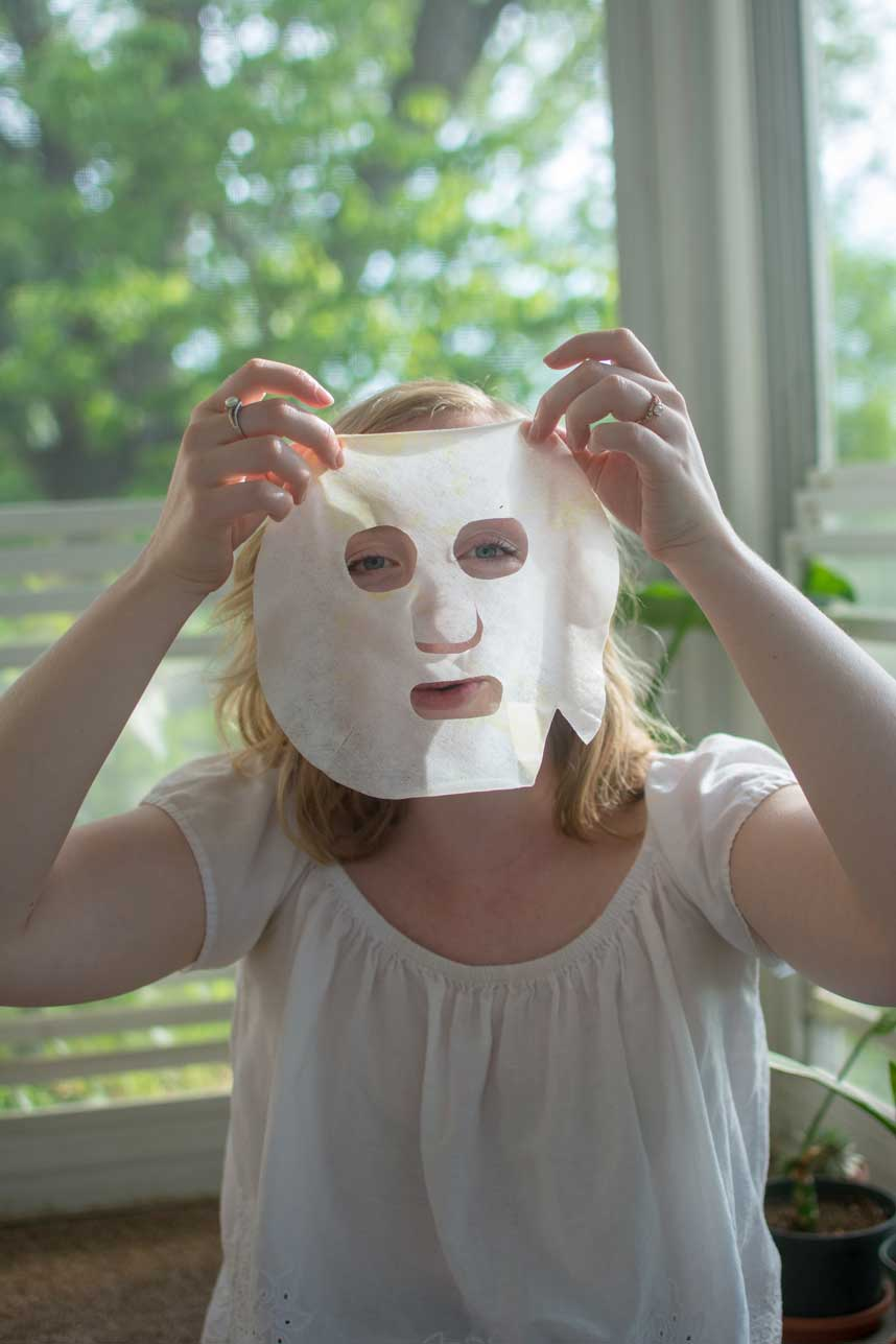 Woman making her own cannabis infused facial sheet mask at home
