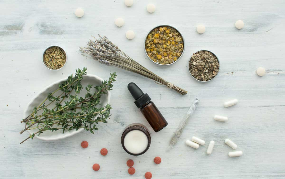 Natural herb supplements and products including dried herbs of lavender and chamomile, fresh thyme, capsules, tablets, tincture, balm