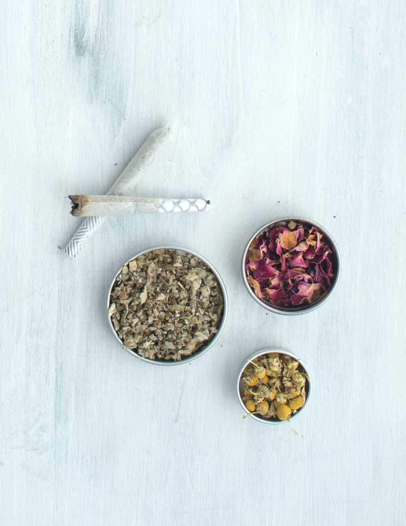 Rose, mullein, and chamomile next to herbal joint cones