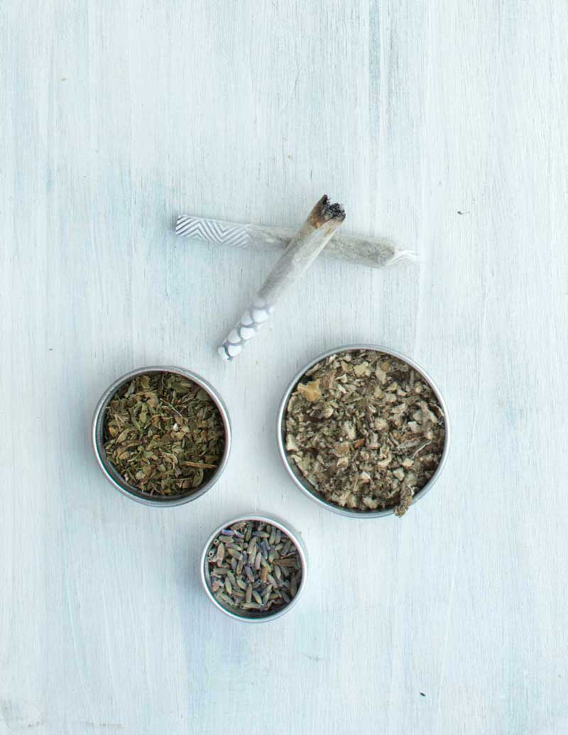 Lavender, peppermint, mullein next to herbal blend joint cones