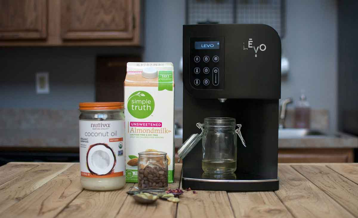 LEVO Oil Infusion machine with ingredients for infused rose cardamom latte recipe