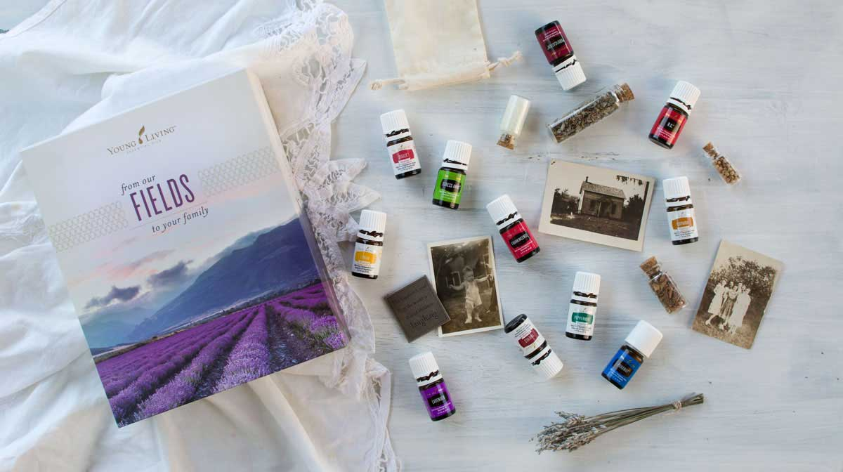 Young Living essential oil starter kit styled with vintage photos and herbs
