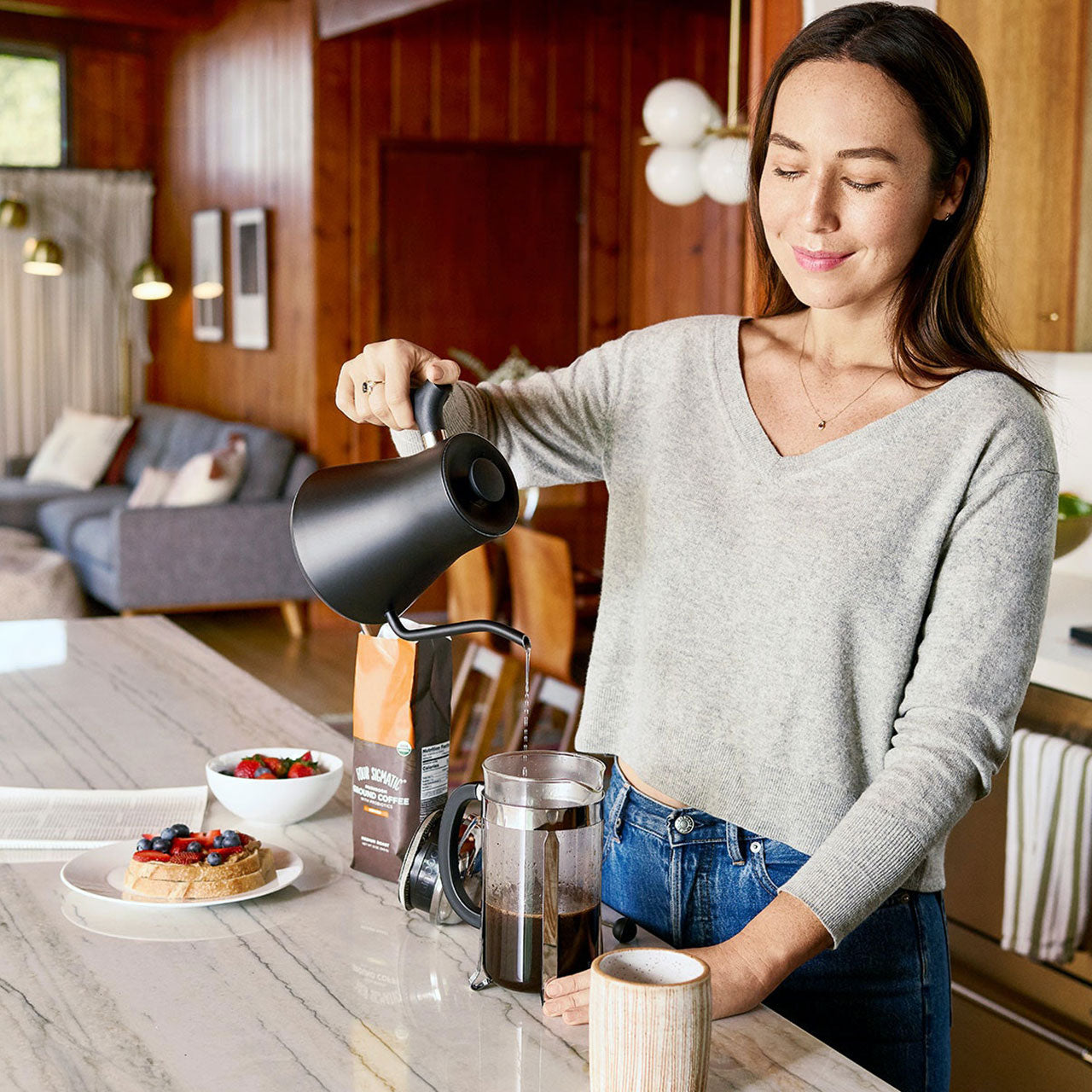 Woman pouring Four Sigmatic Mushroom Coffee